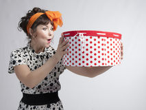 Happy girl holding gift box with red polka dots Royalty Free Stock Photo