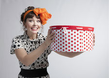 Happy girl holding gift box with red polka dots Stock Photo