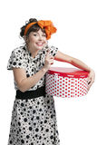 Happy girl holding gift box with red polka dots Stock Photos