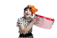 Happy girl holding gift box with red polka dots Royalty Free Stock Photos