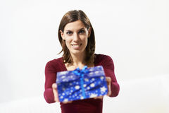 Happy girl holding gift box to the camera stock photos