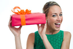 Happy girl holding gift. Happy woman holding gift box, isolated on white background Stock Images