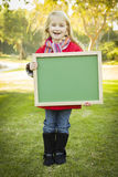 Happy Girl Holding a Green Chalkboard Wearing Coat Stock Photos
