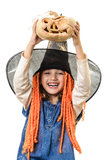 Happy girl holding Halloween pumpkin Royalty Free Stock Image