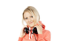 Happy girl holding headphones Stock Photos