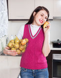 Happy  girl holding  heap of pears Royalty Free Stock Photo