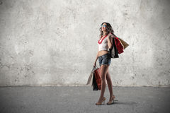 Happy girl holding many shopping bags Royalty Free Stock Image