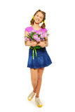 Happy girl holding pail with pink tulips. With two arms on the white background royalty free stock photography