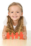 Happy girl holding paper people. Family concept royalty free stock photo
