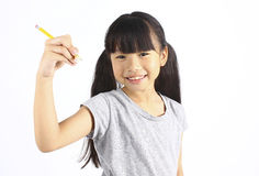Happy girl holding pencil. With white background Stock Photos