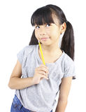 Happy girl holding pencil Stock Photo