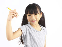 Happy girl holding pencil Stock Image