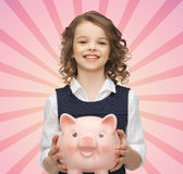 Happy Girl Holding Piggy Bank Royalty Free Stock Photo
