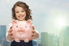 Happy girl holding piggy bank Royalty Free Stock Photos