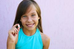 Happy girl holding pill in hand. royalty free stock photos