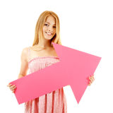 Happy girl holding pink arrow Royalty Free Stock Photography