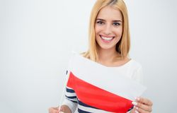Happy girl holding Polish flag Royalty Free Stock Images