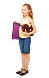 Happy girl holding purple folder and violin Royalty Free Stock Photos