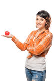 Happy girl holding a red apple Royalty Free Stock Photos