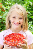 Happy girl holding red currants Stock Photography