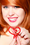 Happy girl holding red heart love symbol. Valentines day. Stock Image