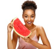 Happy girl holding red ripe watermelon slice. stock photography
