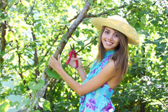 Happy girl holding secateurs Royalty Free Stock Image