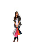 Happy girl holding shopping bags Stock Photo