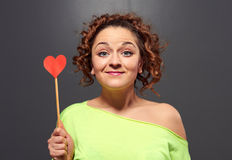 Happy girl holding small red heart Royalty Free Stock Images