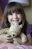 Happy Girl holding a teddy bear stock images