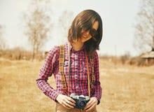 Happy girl holding vintage photo camera Stock Photography