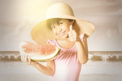 Happy girl holding a watermelon Royalty Free Stock Images