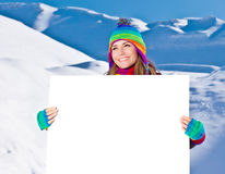 Happy girl holding white board, winter outdoor Royalty Free Stock Photo