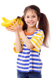 Happy girl holds a bunch of bananas Stock Image