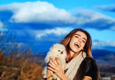Happy girl holds cute dog Royalty Free Stock Photography