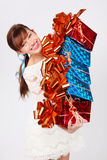 Happy girl holds five boxes with giffs Stock Photography