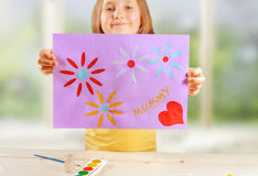 Happy girl holds greeting card Royalty Free Stock Images