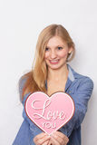 Happy girl holds pink heart I love you Stock Photography