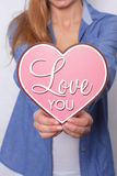 Happy girl holds pink heart I love you Royalty Free Stock Images