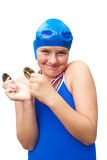 Happy girl holds swimming medals Stock Image