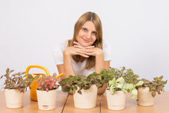 Happy girl home indoor plants Royalty Free Stock Photo