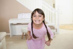 Happy girl at home stock photography