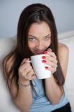 Happy girl with hot drink Stock Photos