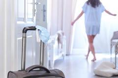 Girl in a hotel room. COVID-era