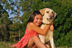 Happy girl hugging a dog Royalty Free Stock Photography