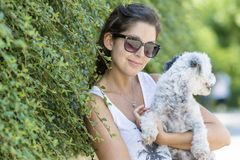 Beautiful young woman hugging her  dog. Happy girl  hugging dog outdoor Stock Images