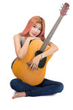 Happy girl hugging a guitar. Royalty Free Stock Photo