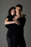 Happy girl hugging a guy Royalty Free Stock Images
