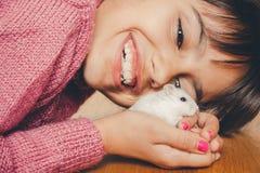 Happy girl hugging her hamster Stock Photo