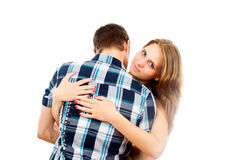 Happy girl hugging a loved one guy. Isolated on white background Stock Photos